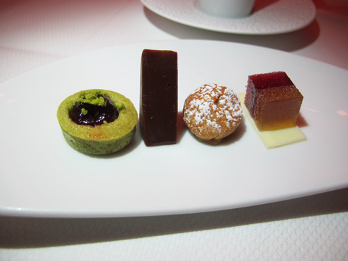 Mignardises: pistachio and cherry financier, chocolate and caramel ...